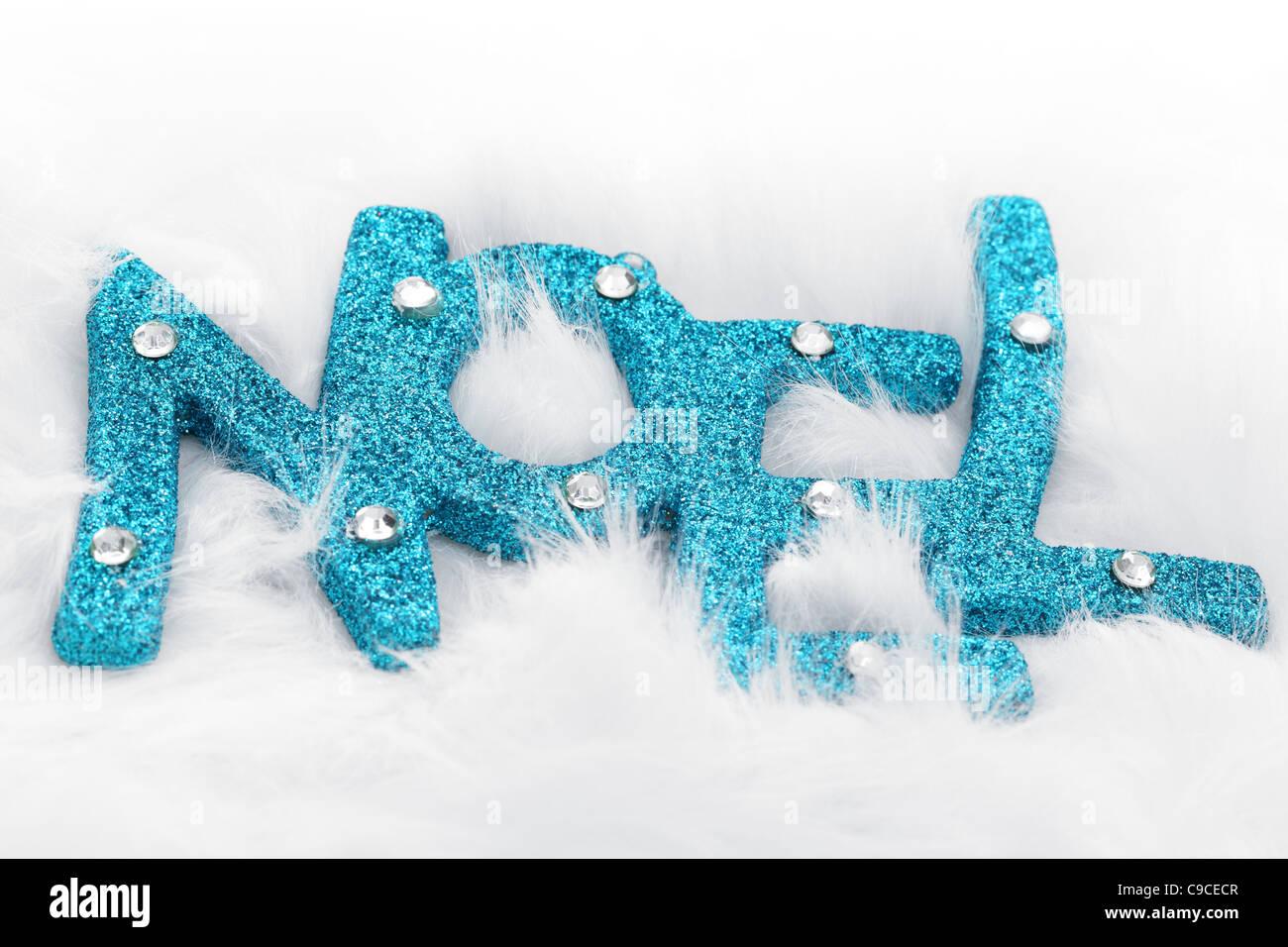 Glitter NOEL in white fluff - Stock Image