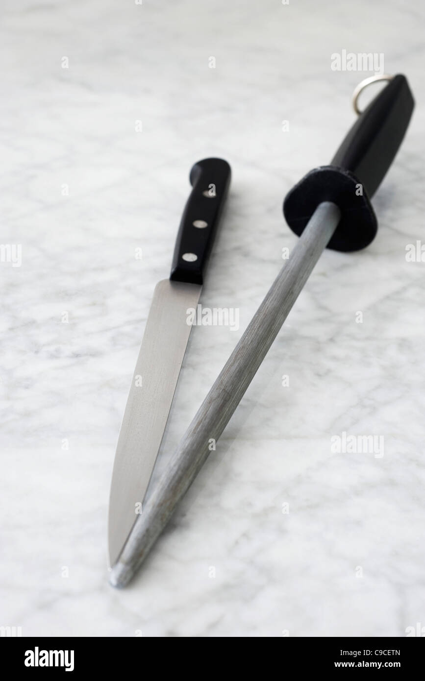 Carving knife and knife sharpener - Stock Image