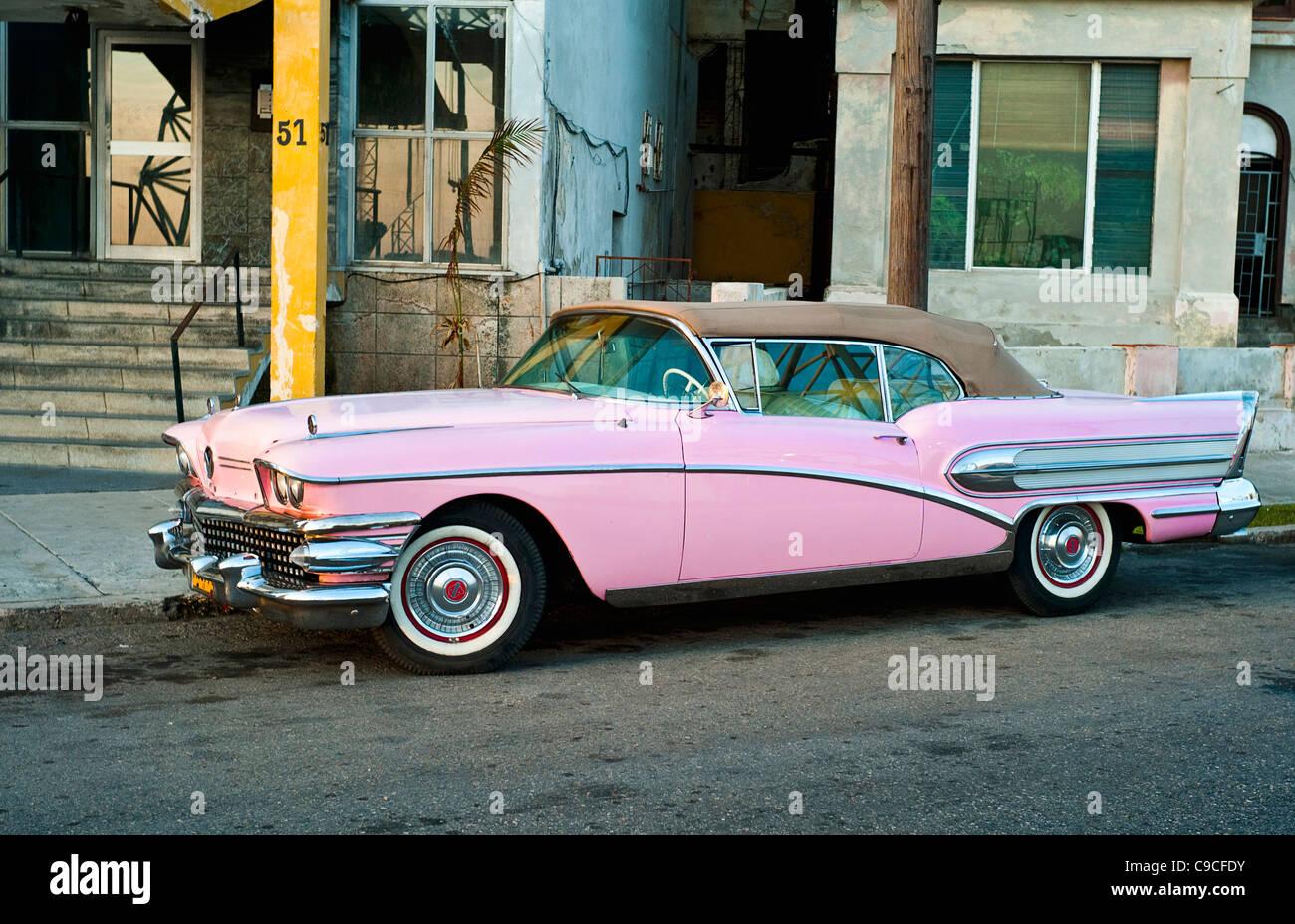Cuba, Caribbean, Havana, Pink vintage Buick convertible car with the ...