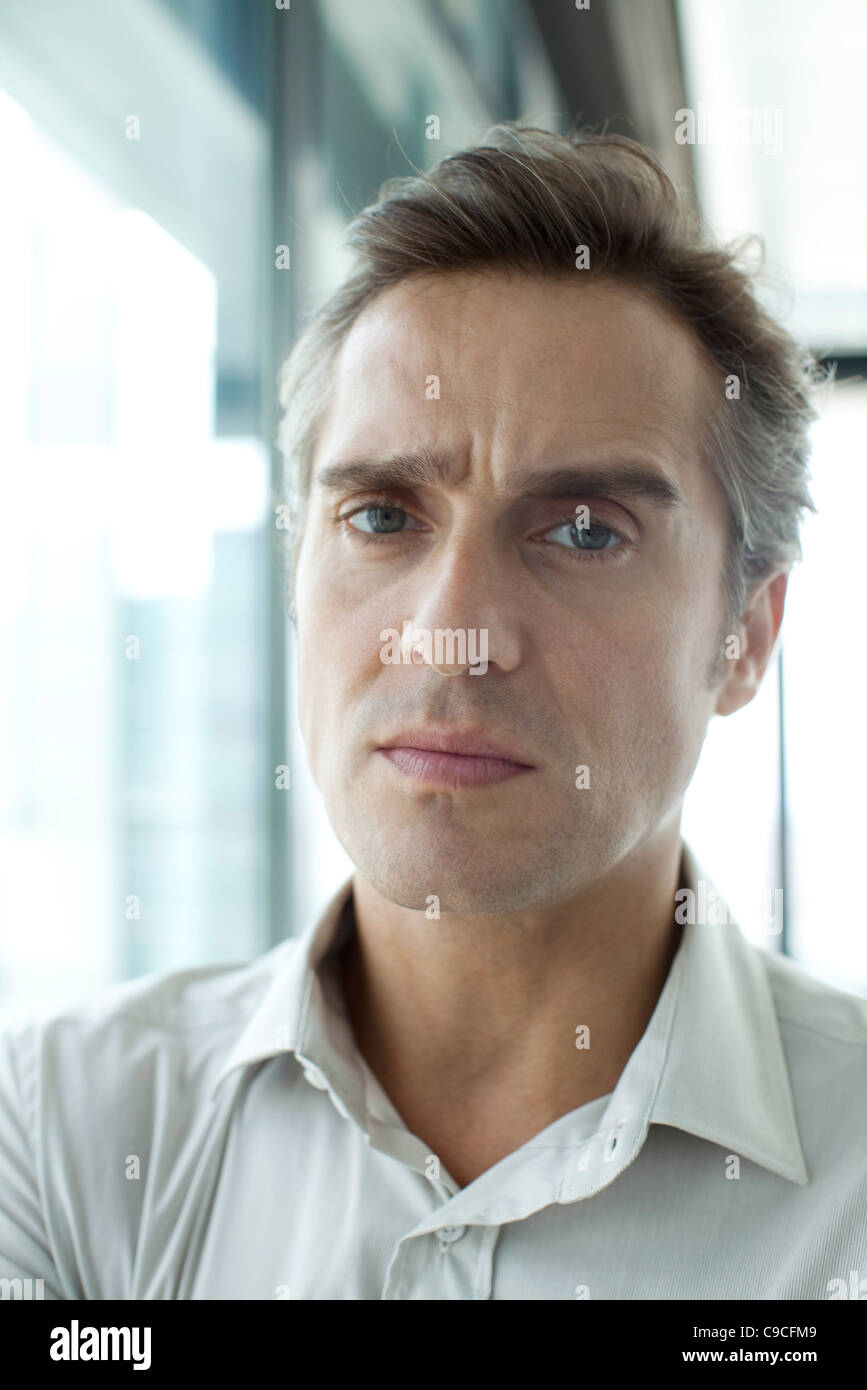 Man with worried expression - Stock Image