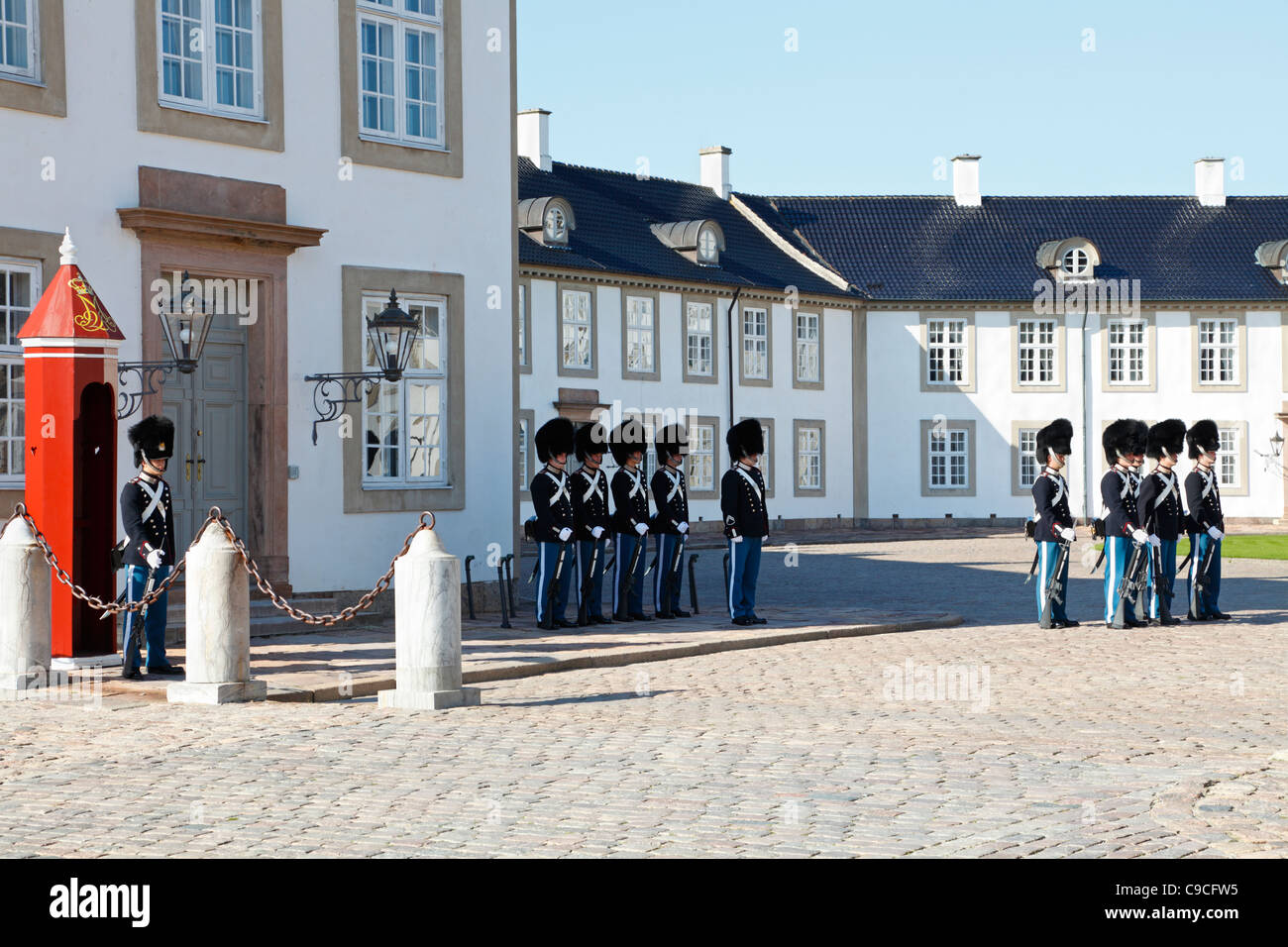 Bearskin sentries from the Royal Life Guards at the change of guards at the Fredensborg Palace near Copenhagen, - Stock Image
