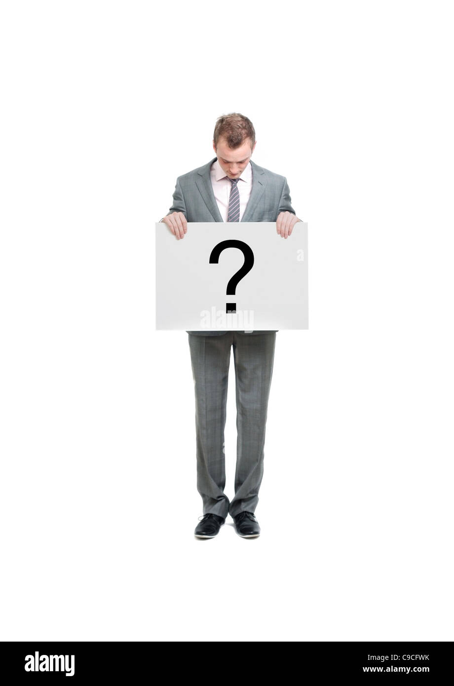 A business man holding a question mark - Stock Image