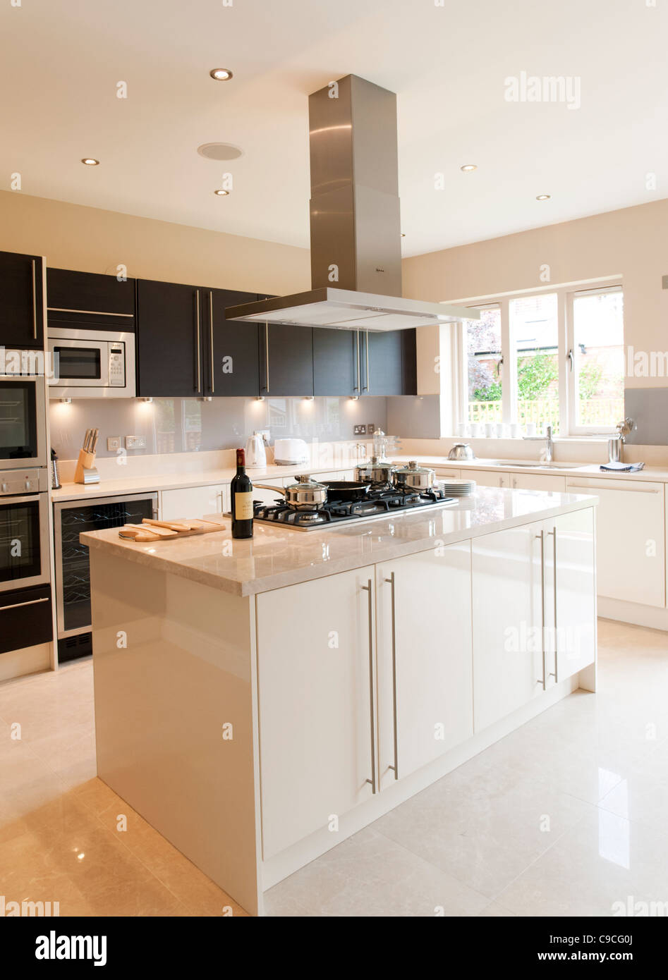New modern fitted kitchen in large house, England, UK - Stock Image