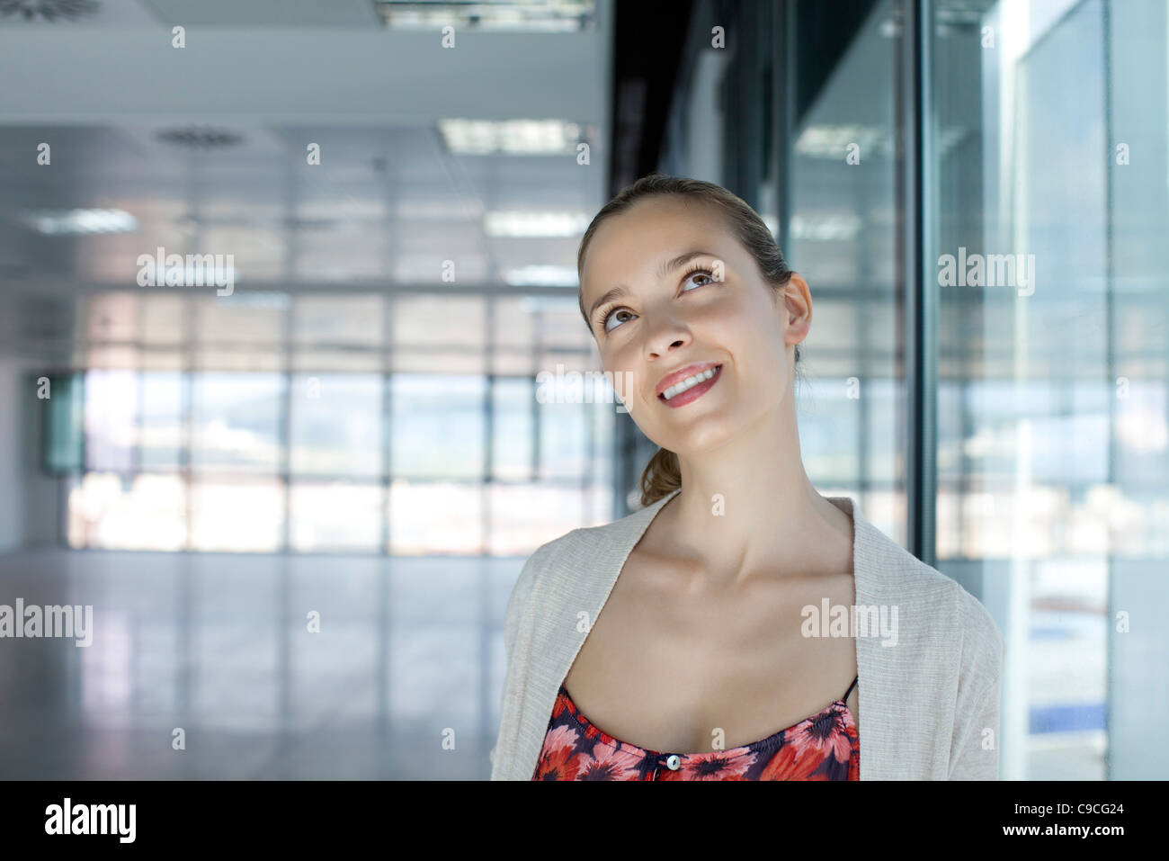 Woman looking up with head tilted - Stock Image