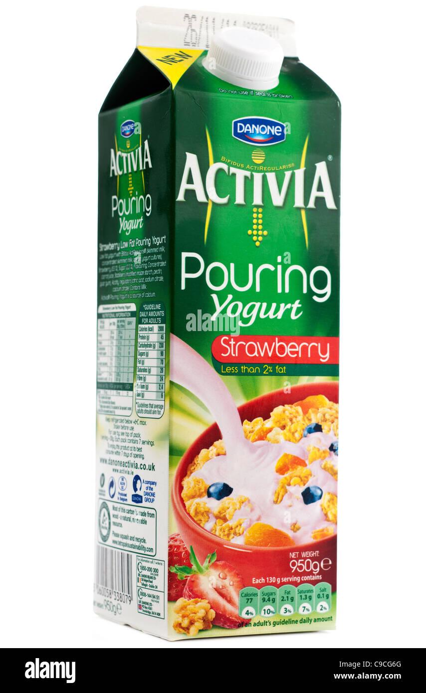 950g carton of danone activia strawberry flavour pouring yogurt