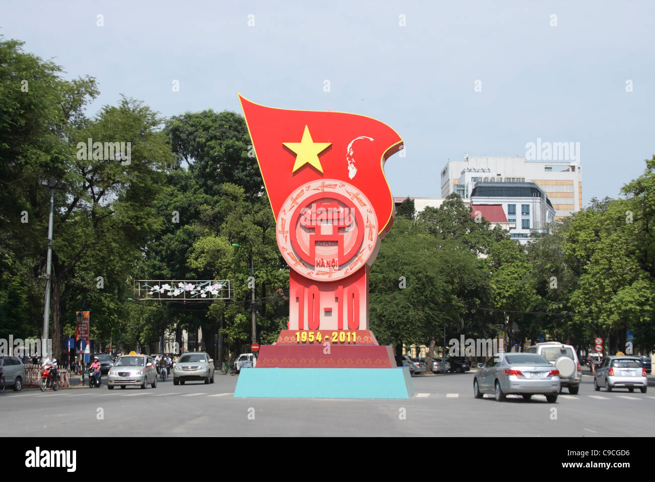 monument at a busy street to commemorate 57th anniversary of Hanoi's Liberation Day (October 10, 1954-2011) - Stock Image