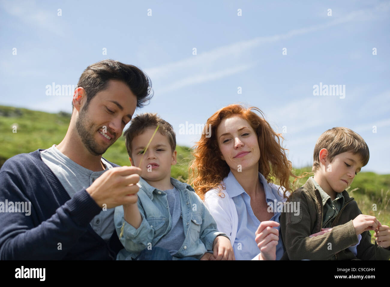 Parents and young boys in nature Stock Photo