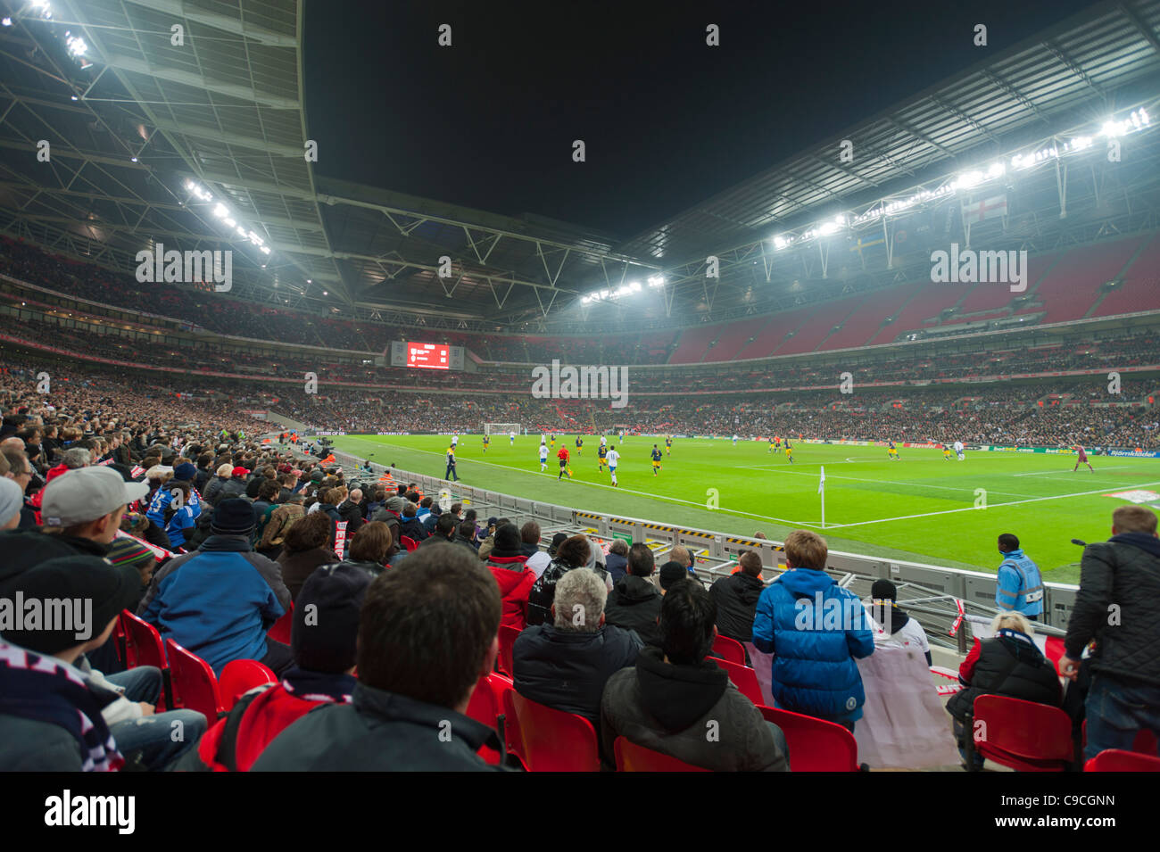 The interior of the new Wembley Stadium during a friendly evening international football match. (England vs Sweden - Stock Image