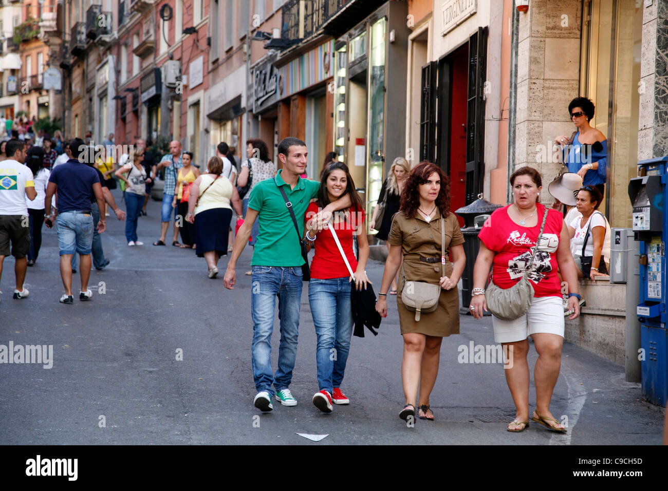 People walking at Via Giuseppe Manno, a pedestrian street with many shops, Cagliari, Sardinia, Italy. - Stock Image