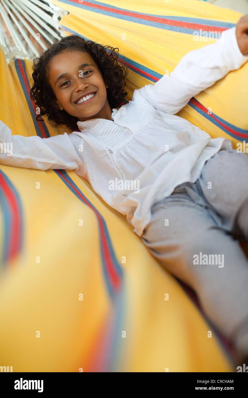Girl lying in hammock, portrait - Stock Image