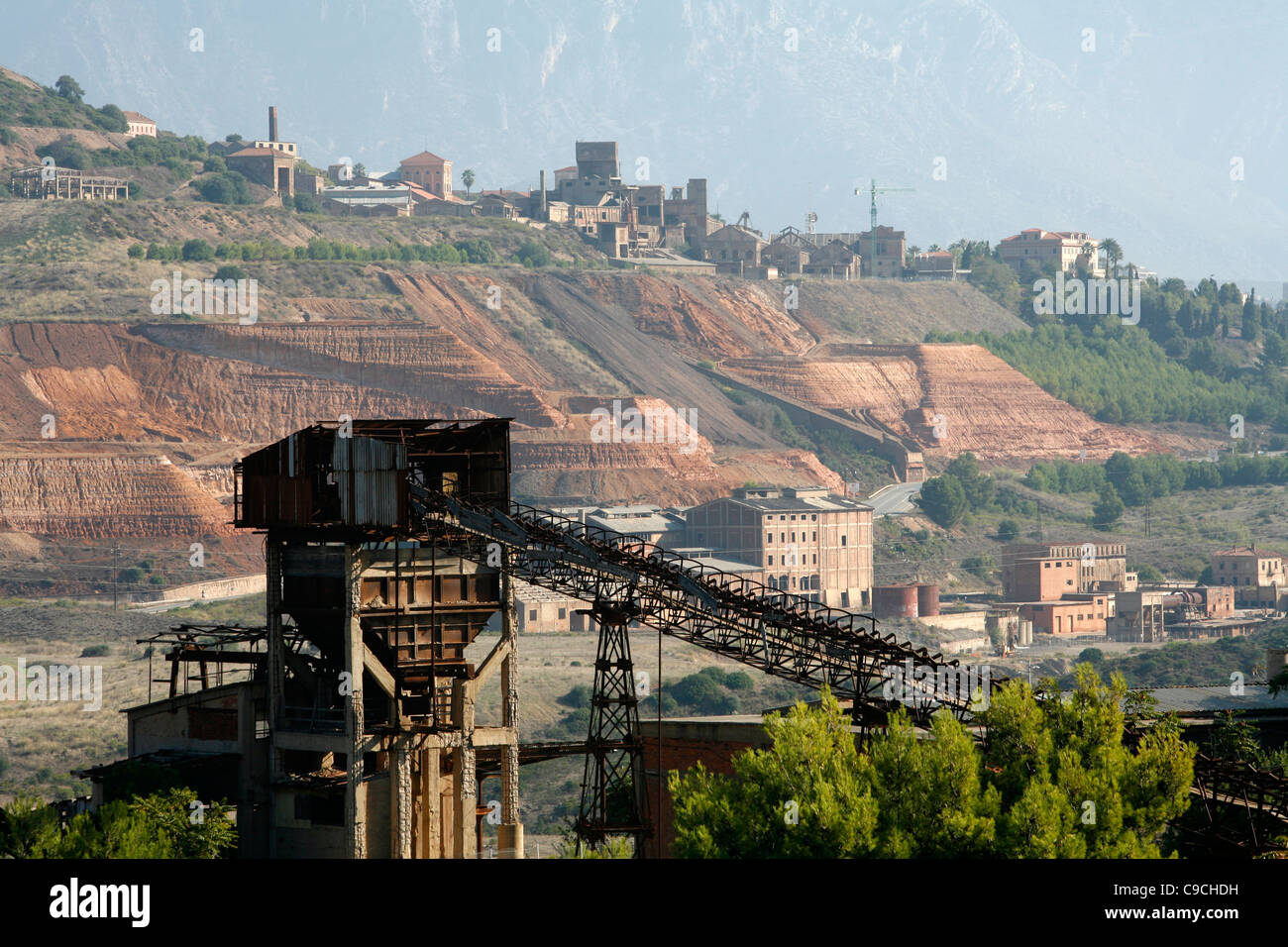 View over the Monteponi mines seen from the San Giovanni mines, Iglesias, Sardinia, Italy. - Stock Image