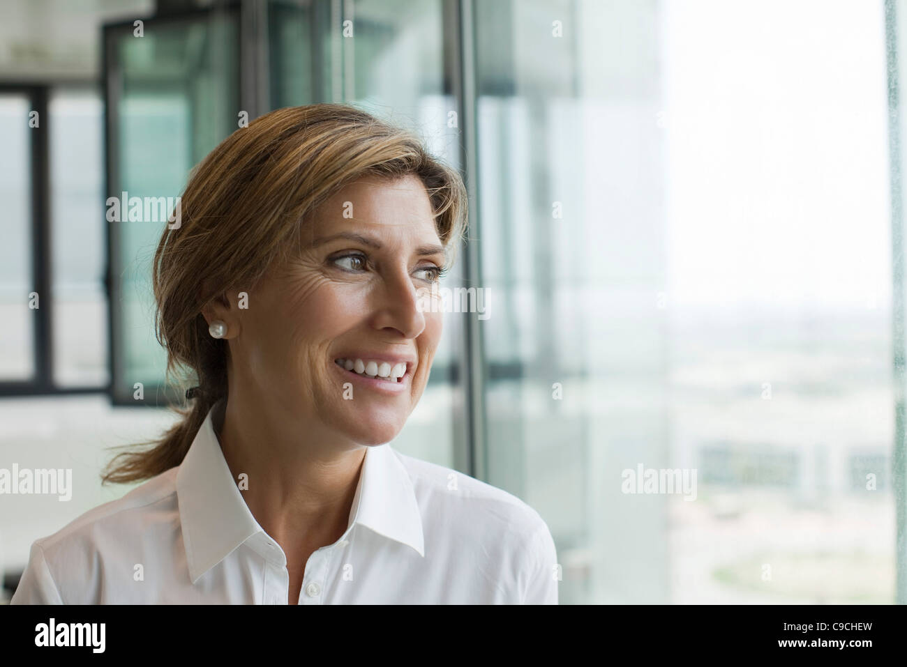 Professional woman smiling - Stock Image