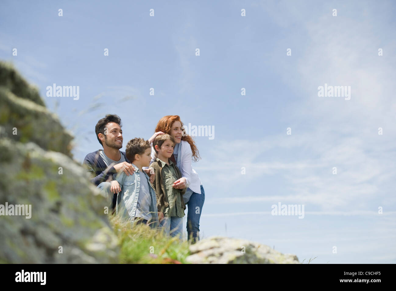 Parents and young boys in nature - Stock Image