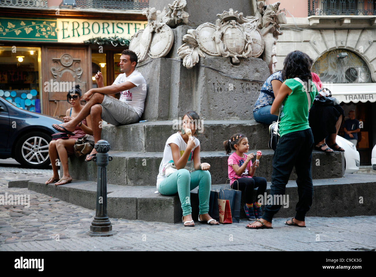People eating ice cream at Via Giuseppe Manno, a pedestrian street with many shops, Cagliari, Sardinia, Italy. - Stock Image