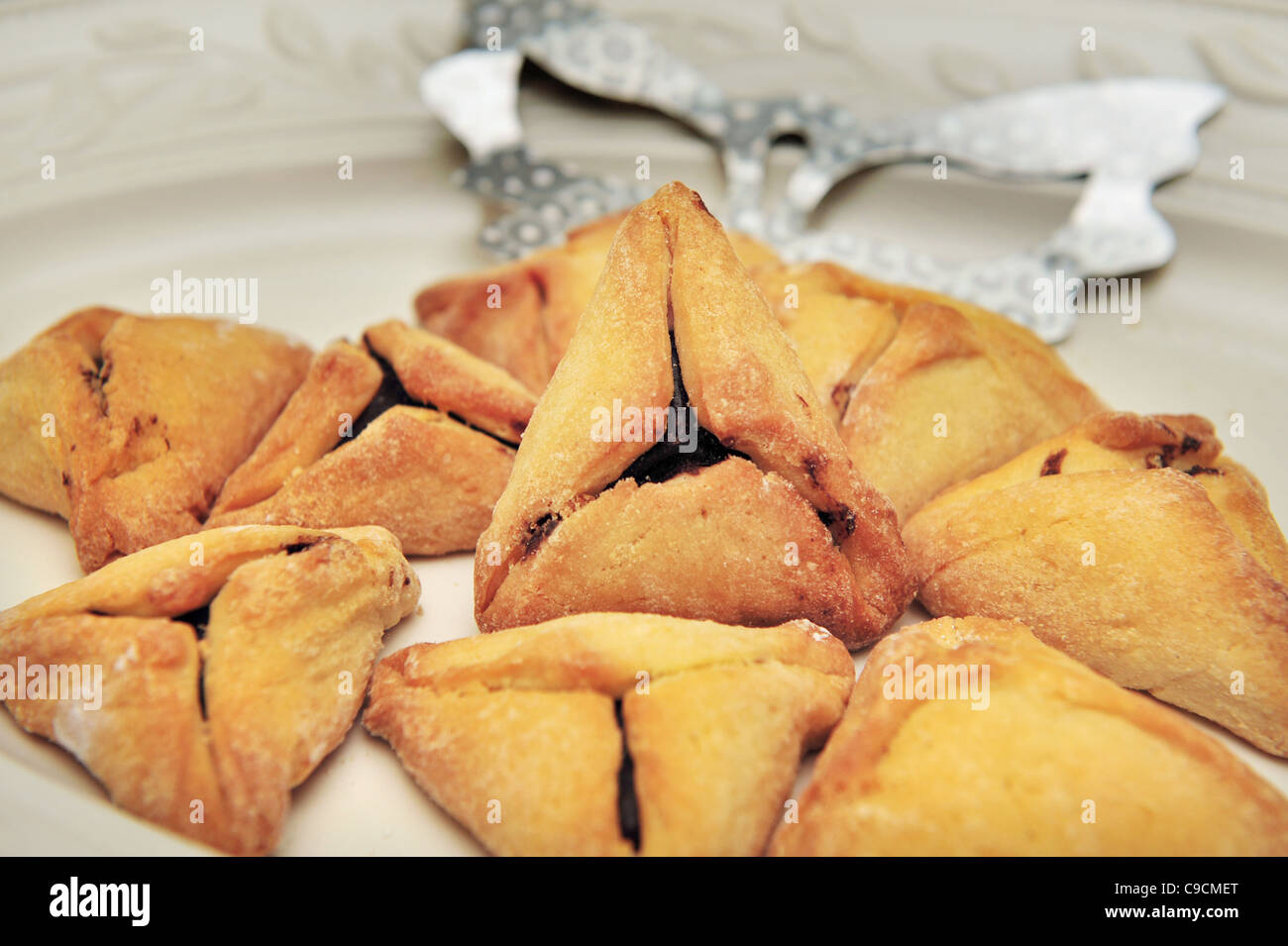 A hamantash is a pastry in Ashkenazi Jewish cuisine, traditionally eaten during the Jewish holiday of Purim. - Stock Image