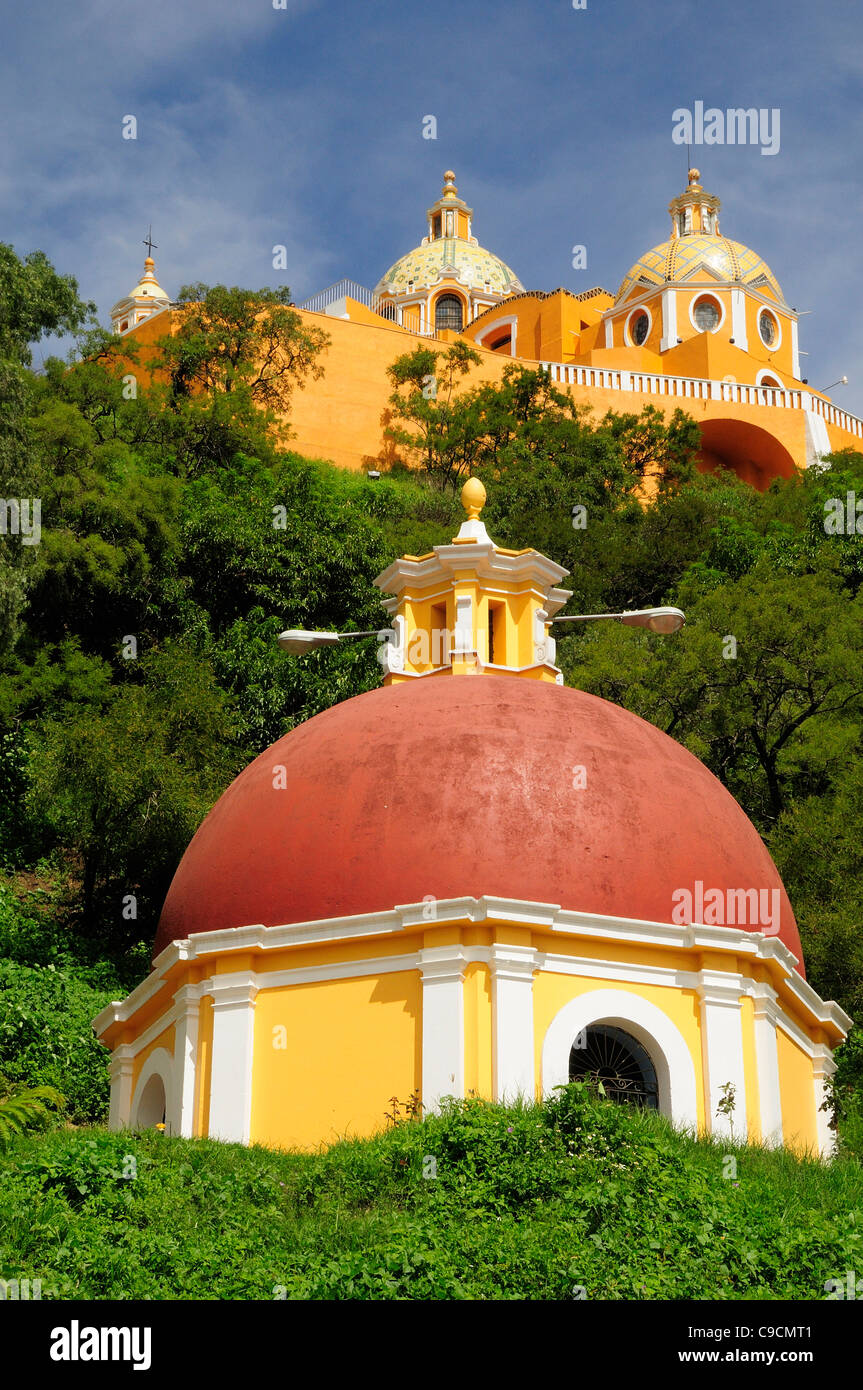 Mexico, Puebla, Cholula, Church of Neustra Senor de los Remedios on tree covered hillside above the pyramid ruins. Stock Photo