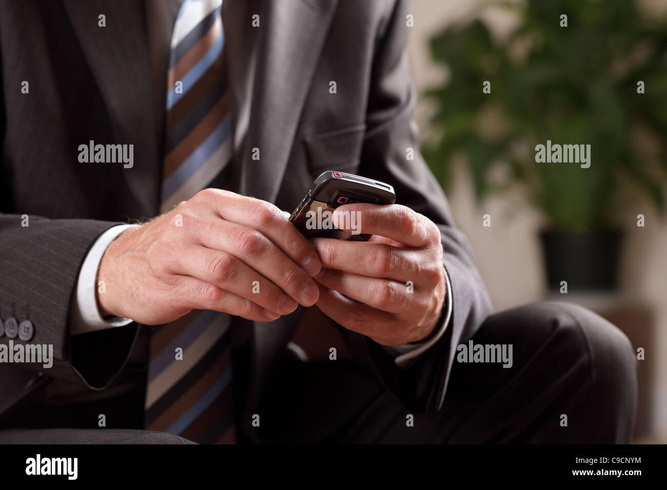 Business man text messaging - Stock Image