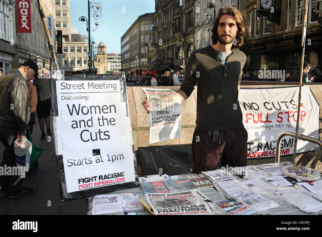 Young male political campaigner objecting to government cuts Newcastle, north east England UK - Stock Image