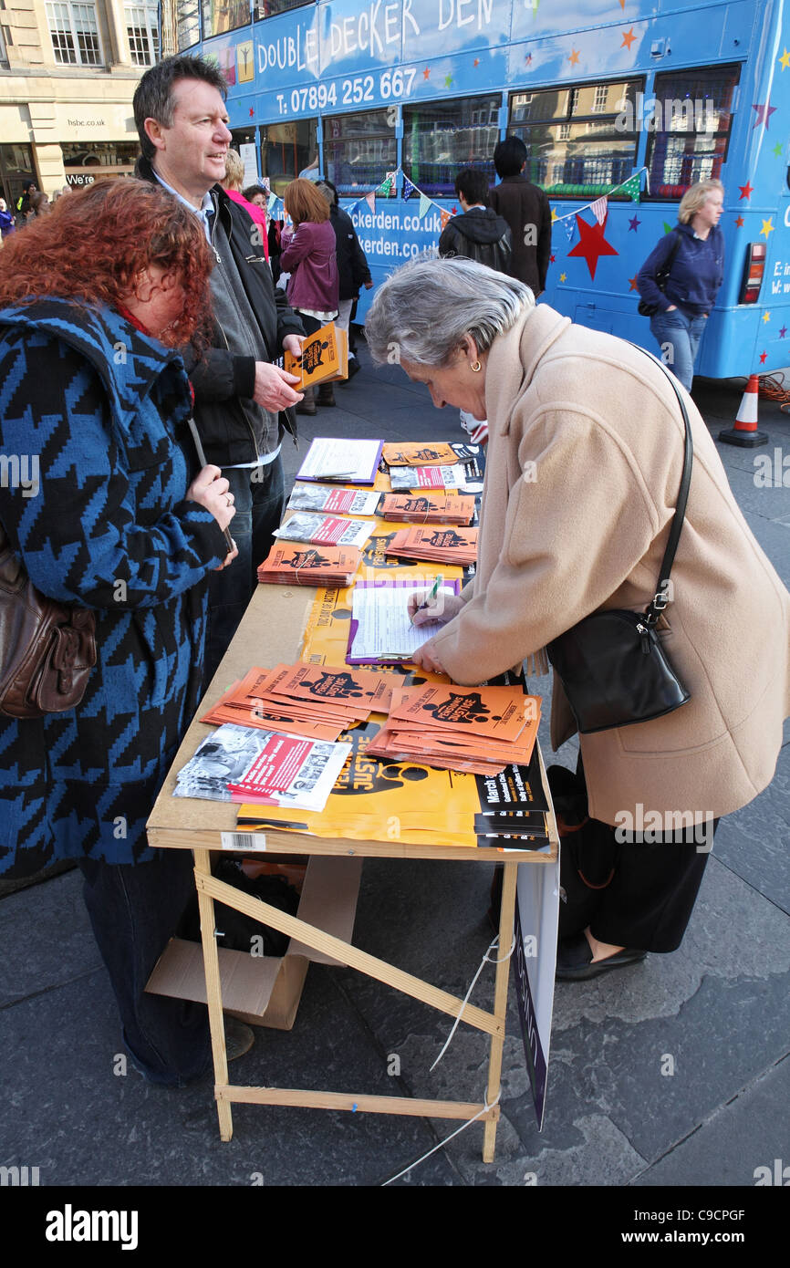 Signing petition against cuts to public service pensions Newcastle, north east England UK - Stock Image