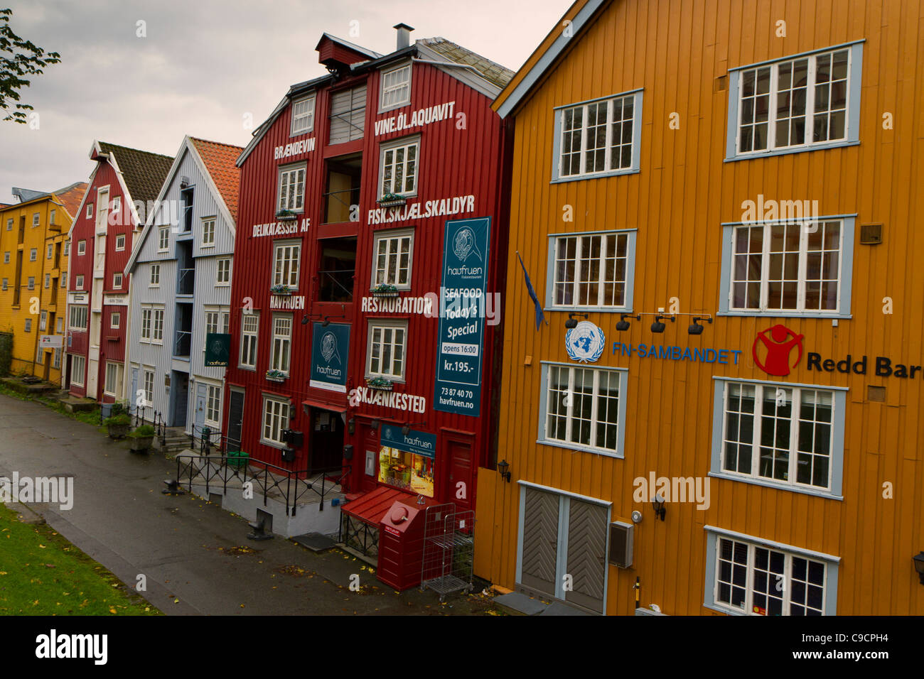 Renovated and gaily painted warehouses on Kjopmannsgata Trondheim Stock Photo