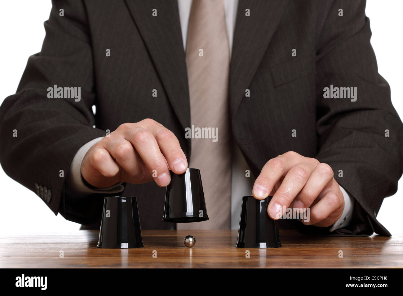 Cup and ball guessing game - Stock Image