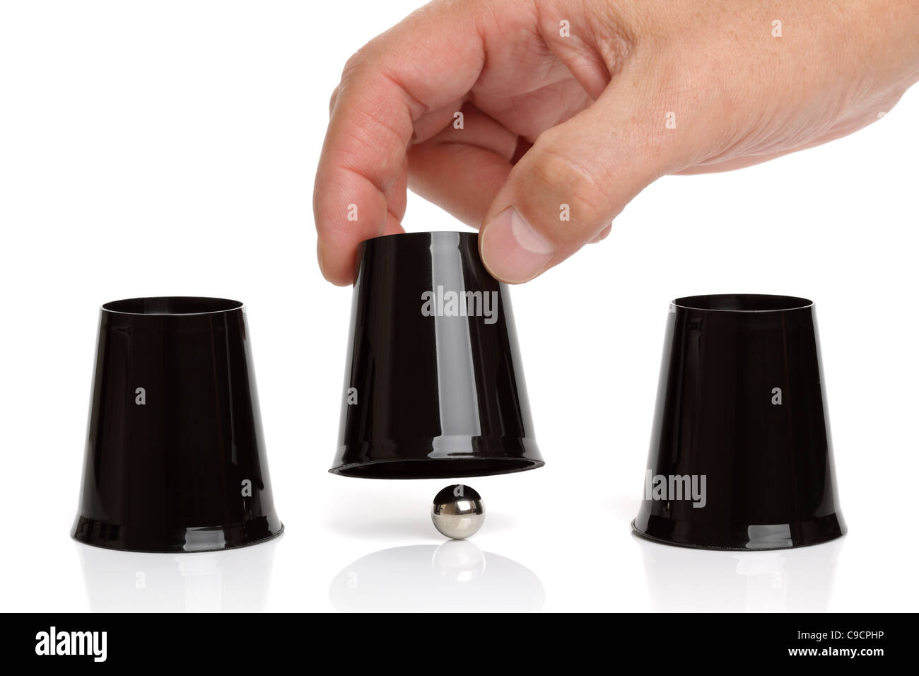 Cup and ball shell game - Stock Image
