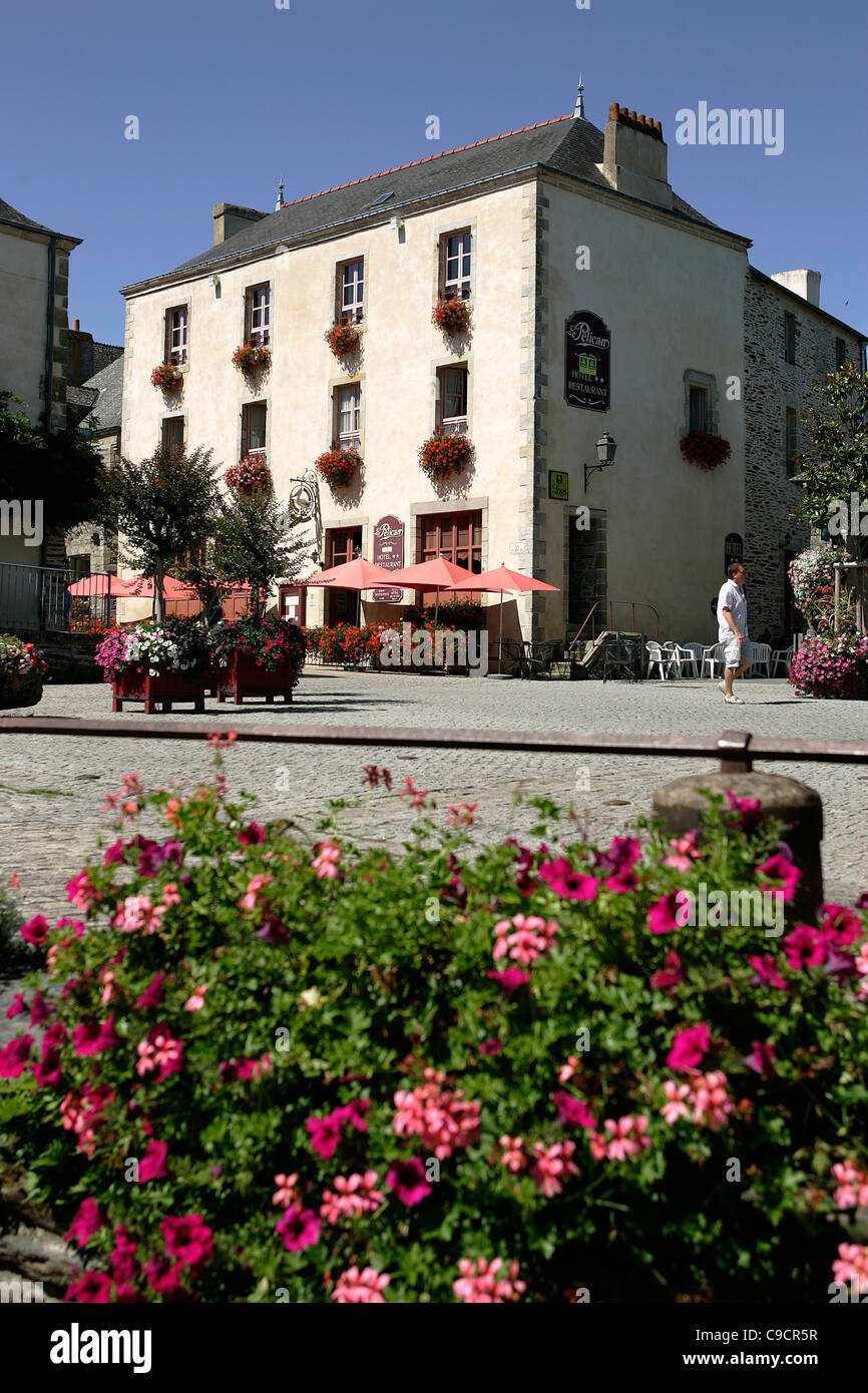 France, Brittany, Morbihan, Rochefort-en-Terre, 56220, 3 story, white stone building, café, flowers in foreground, - Stock Image