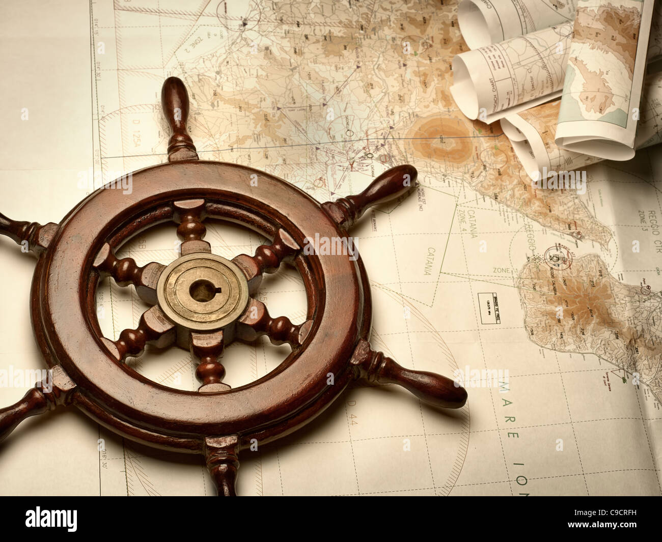 wooden helm on the navigation map,for navigation,travel,adventure themes - Stock Image