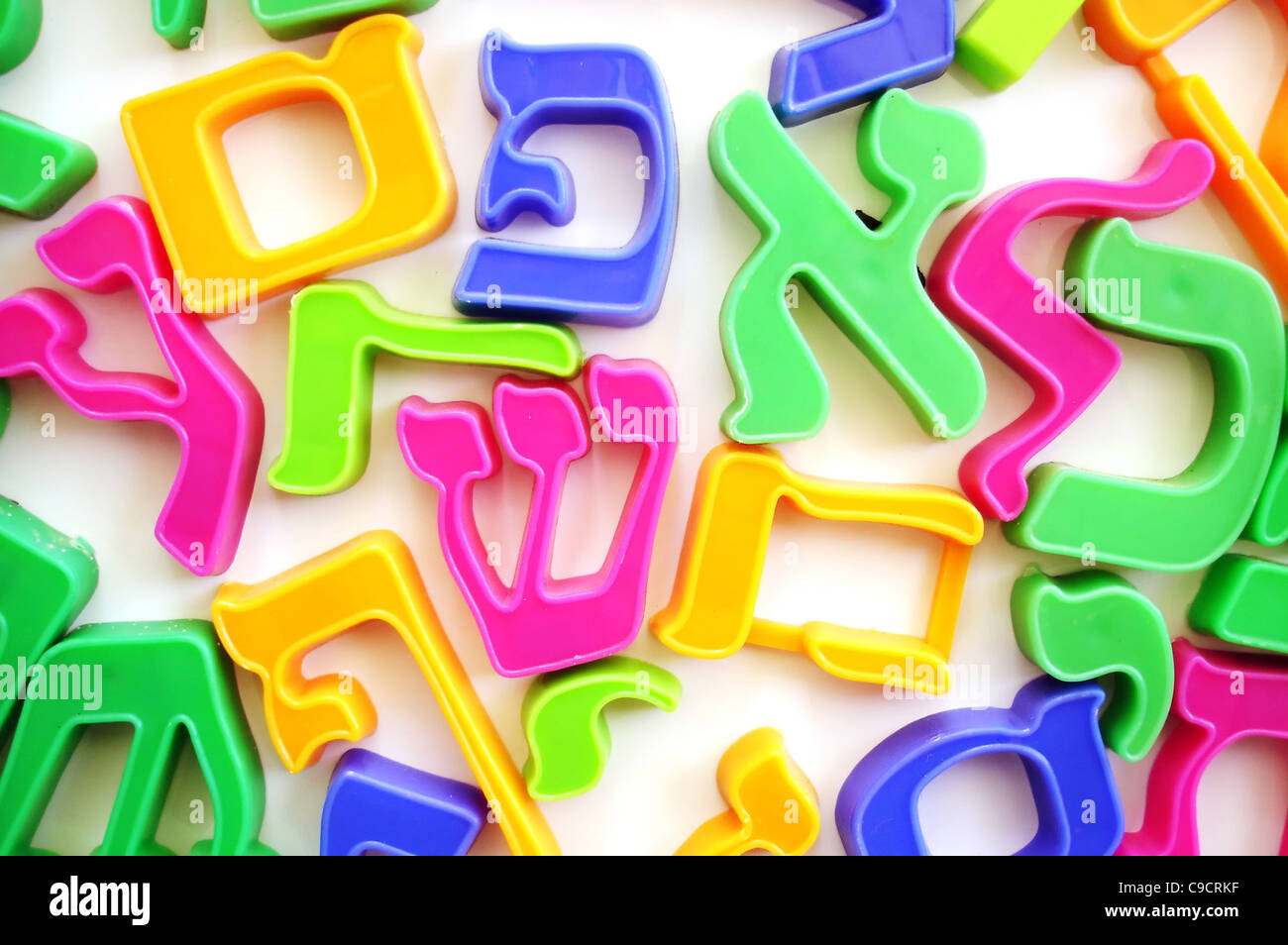 The Hebrew alphabet letters on a fridge which help children to spell. - Stock Image