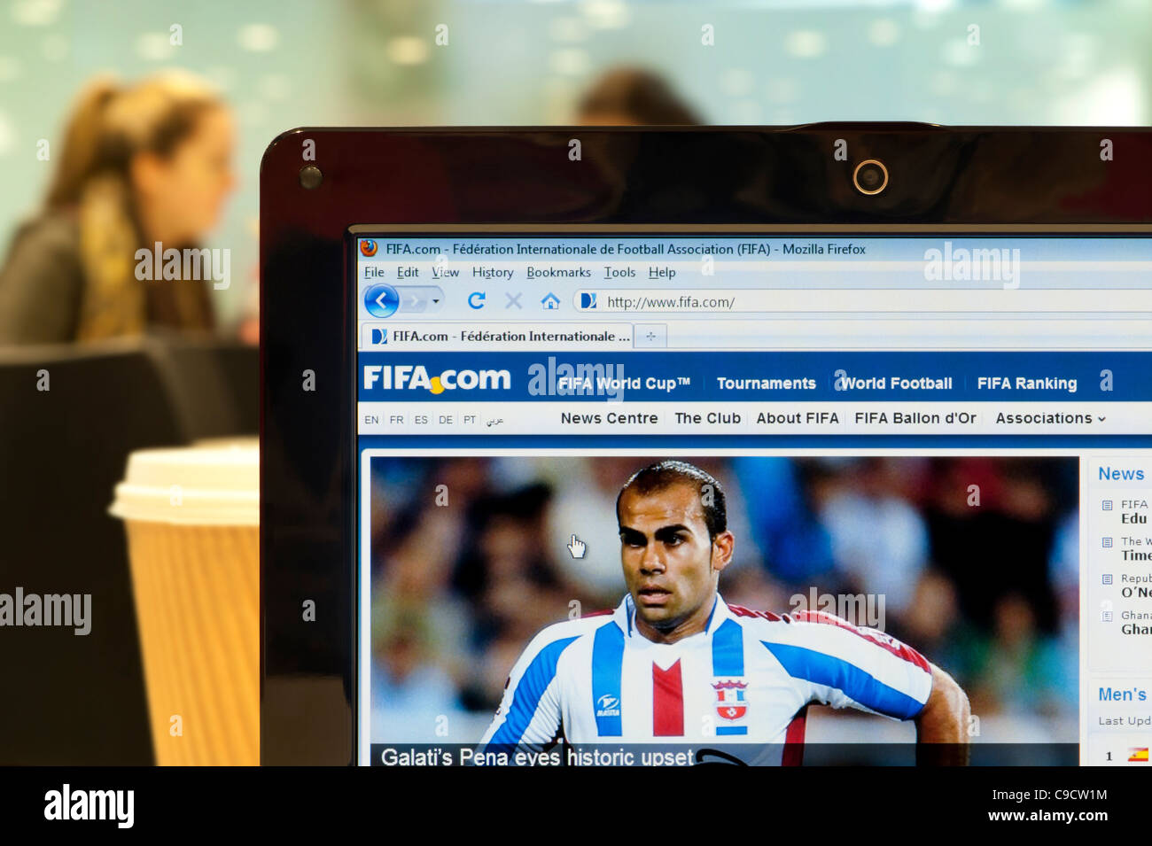 The FIFA website shot in a coffee shop environment (Editorial use only: print, TV, e-book and editorial website). - Stock Image