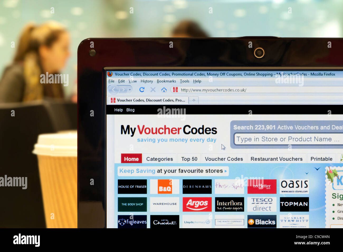 The My Voucher Codes website shot in a coffee shop environment (Editorial use only: ­print, TV, e-book and - Stock Image