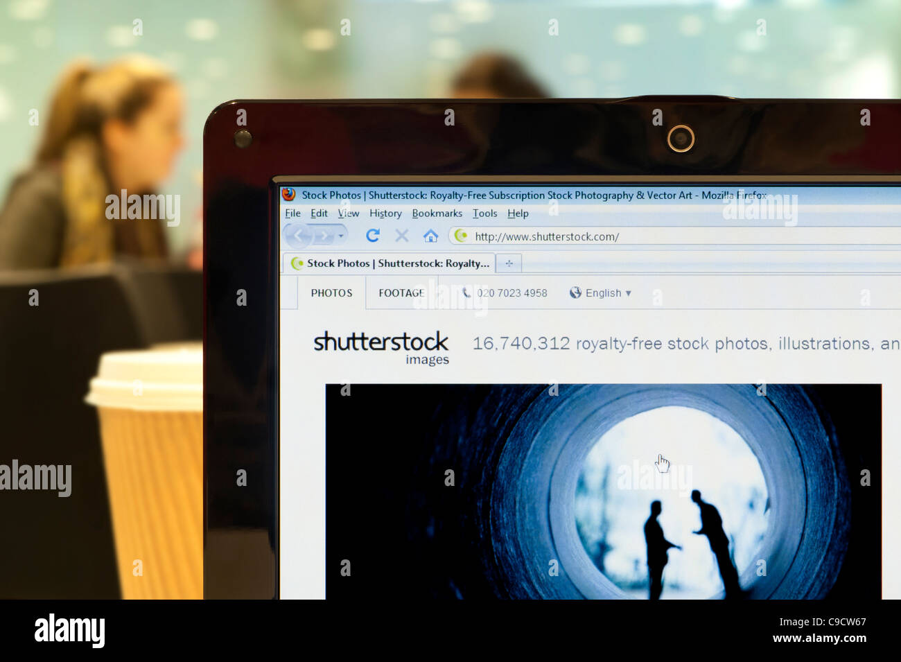 The Shutterstock website shot in a coffee shop environment (Editorial use only: print, TV, e-book and editorial Stock Photo