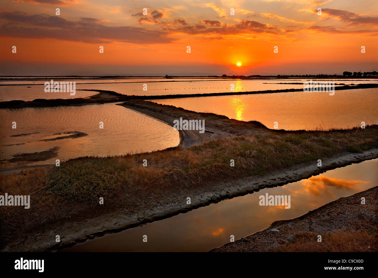 Sunset photo at the lagoon of Angelochori, a wetland about 30 km from Thessaloniki, Macedonia, Greece - Stock Image