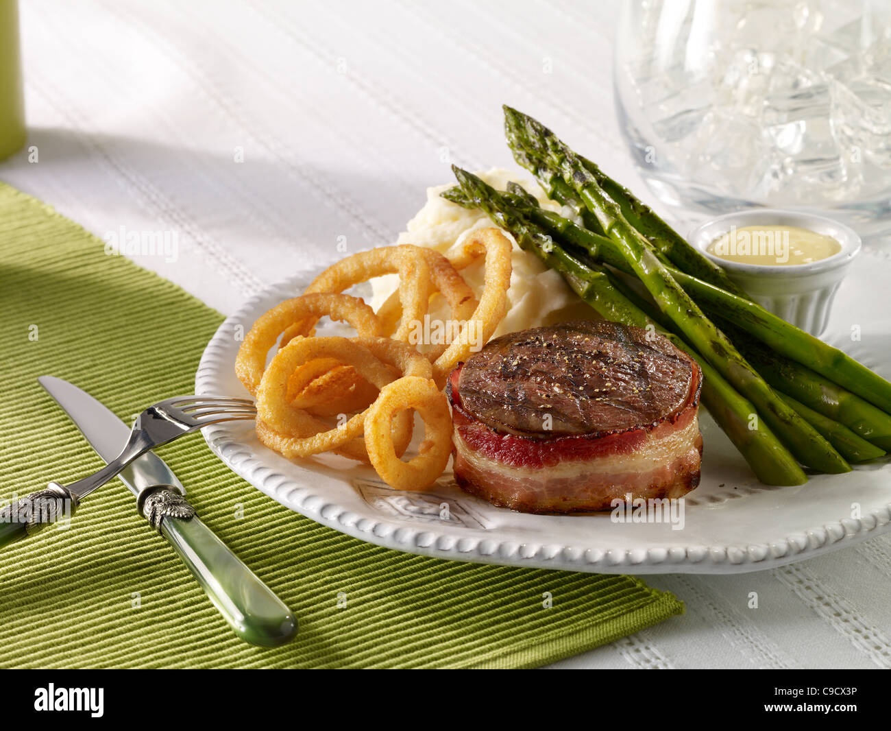 Beef tenderloin served with mash potato, asparagus and onion rings - Stock Image