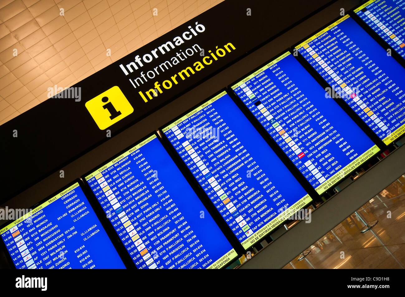 Departures electronic billboard, Barcelona El Prat international airport, Catalonia, Spain - Stock Image