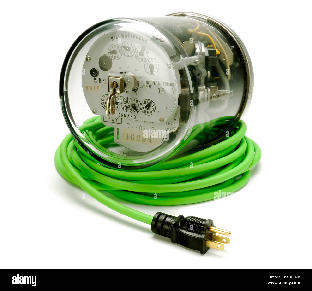 Electrical supply meter with a green electrical power cord and a black plug Stock Photo