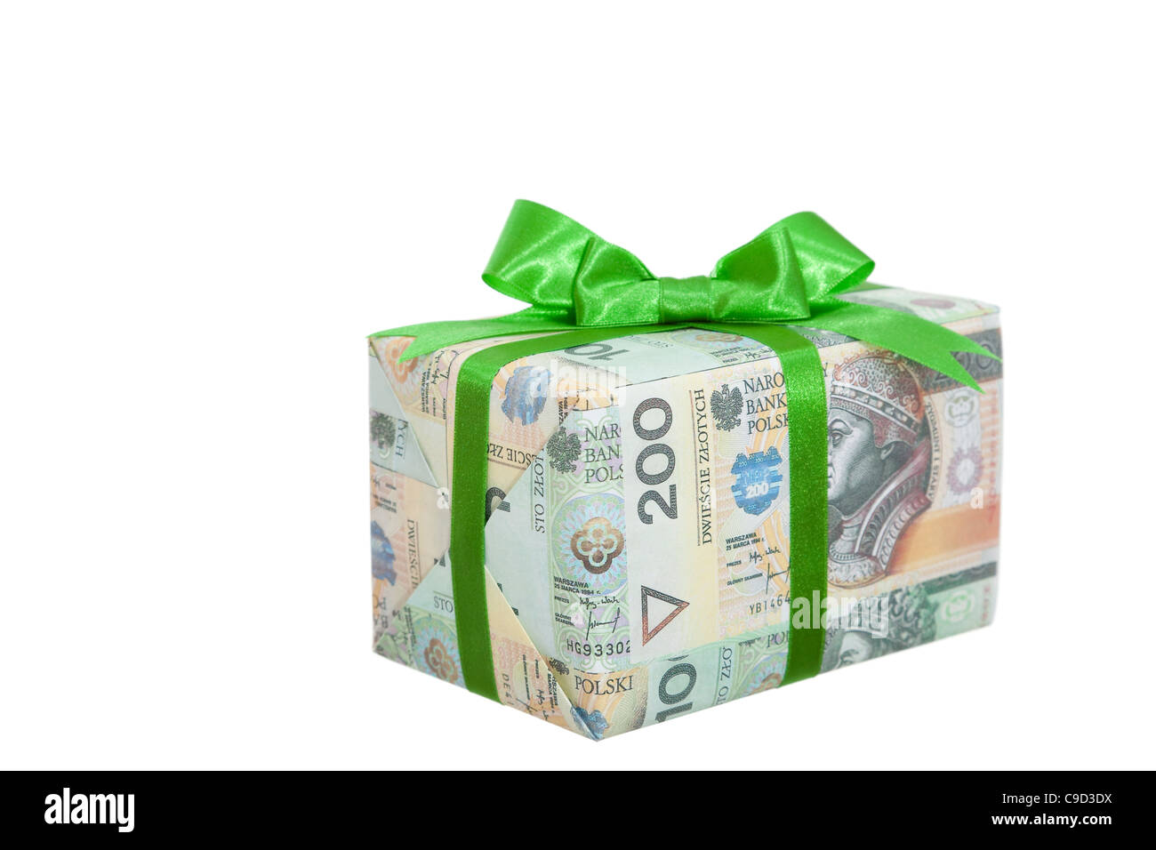 package with money and green ribbon on white - Stock Image