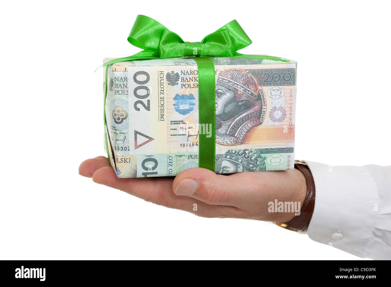 package with money and green ribbon on palm - Stock Image