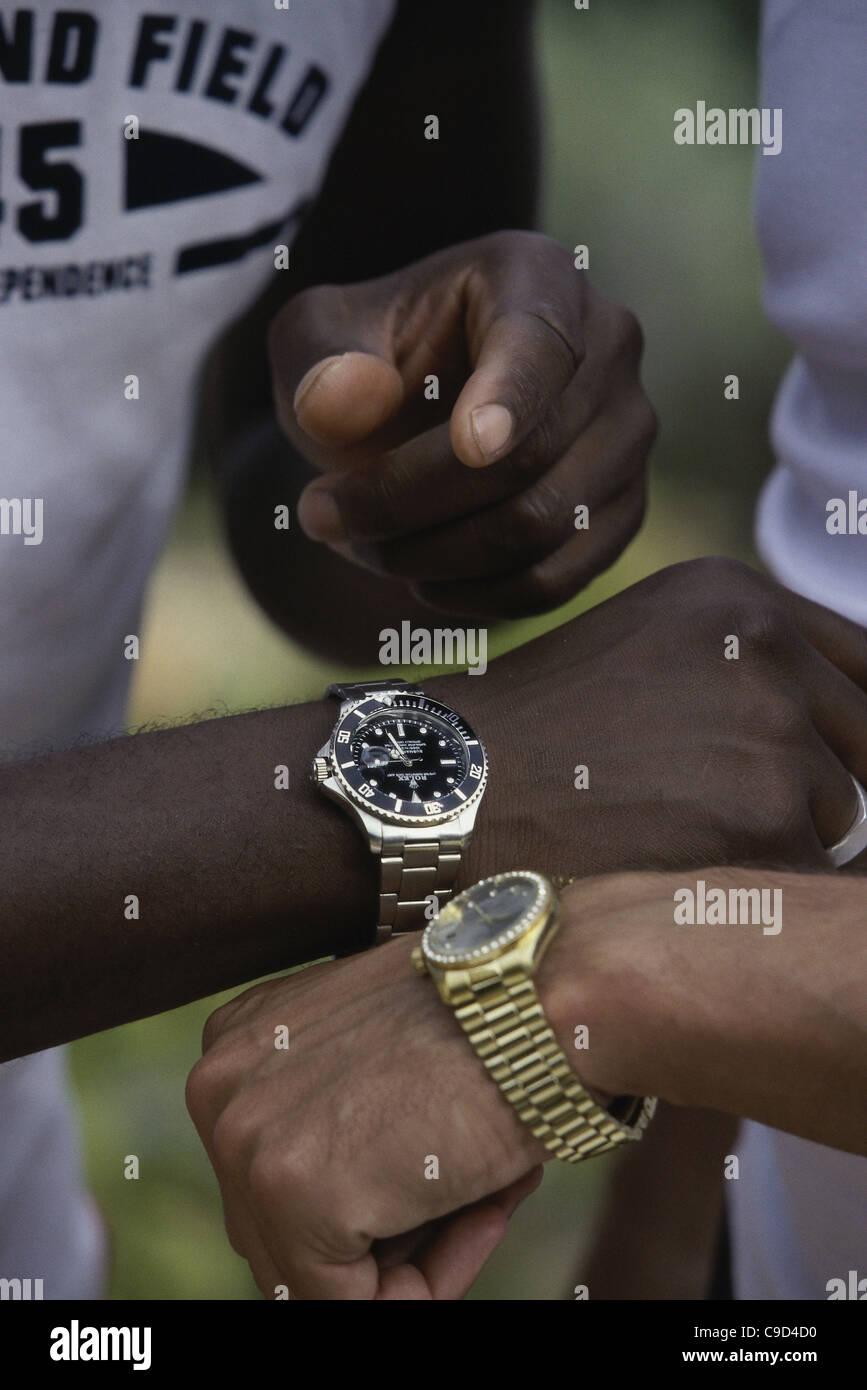 Two people synchronizing their wristwatches - Stock Image