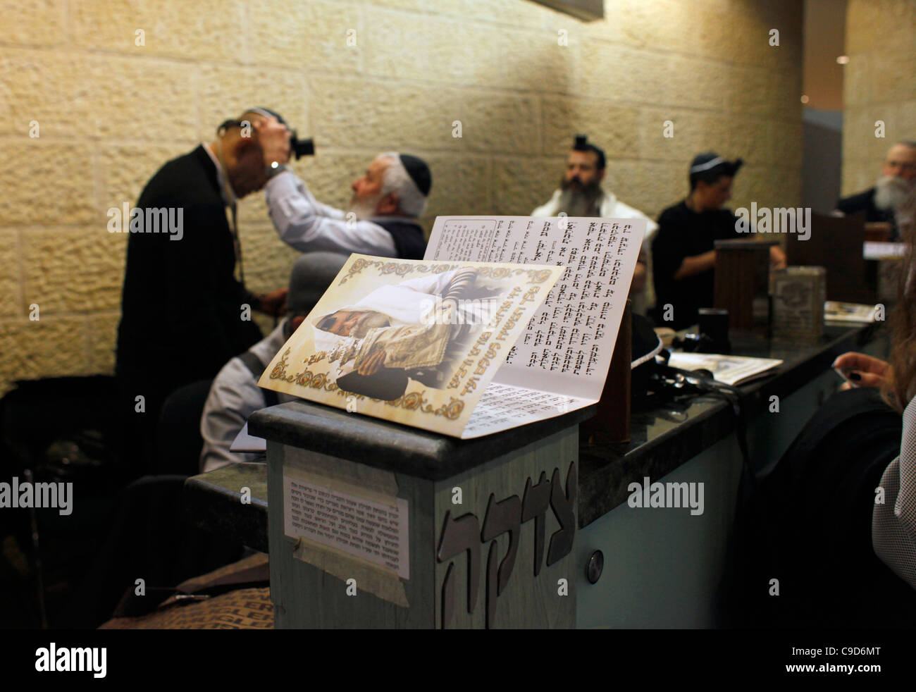 Religious Jews from Habad Lubavitch movement encouraging Jewish passengers to pray and put on Tefillin (phylacteries) - Stock Image