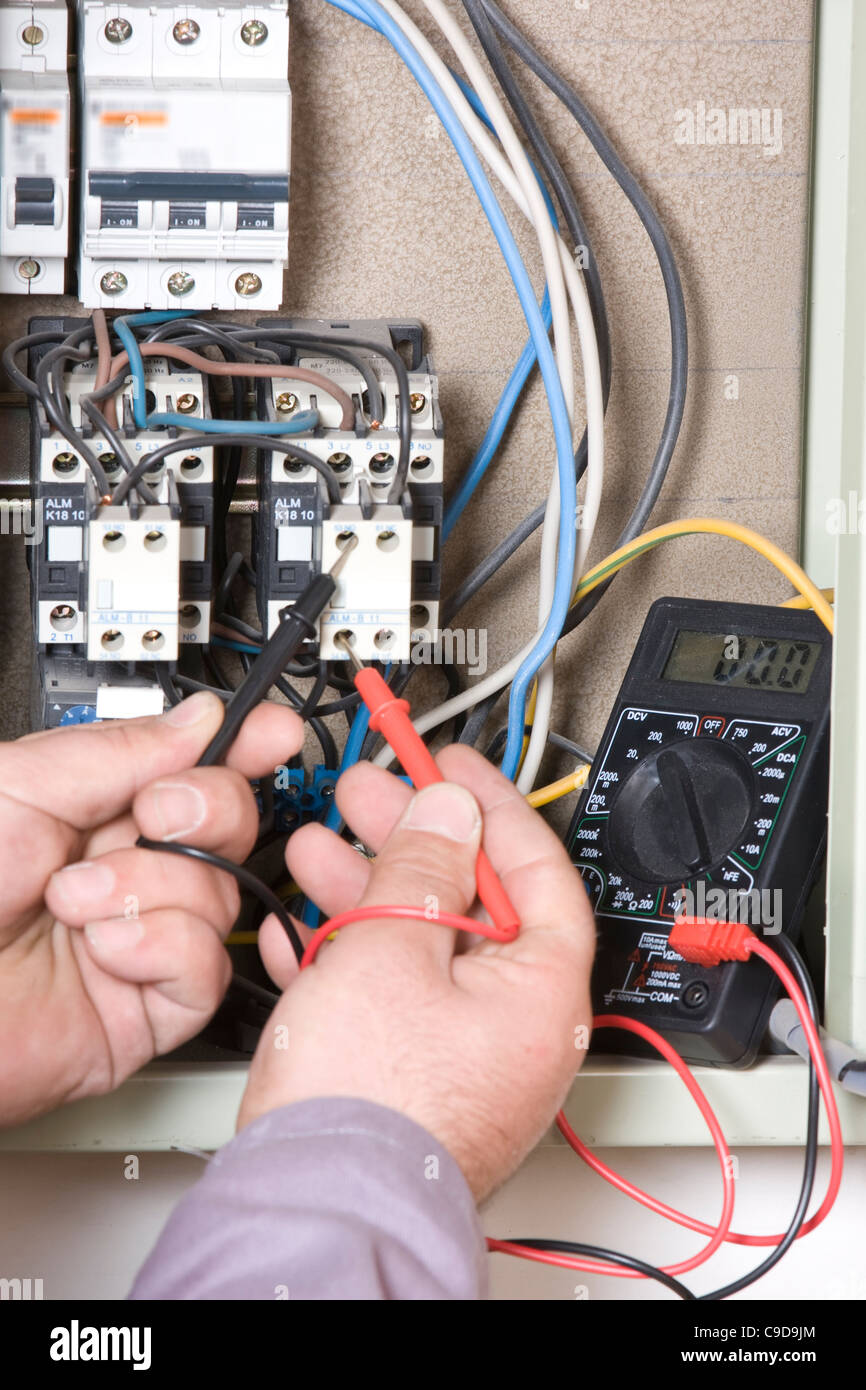 Electrical inspector reading power output - Stock Image