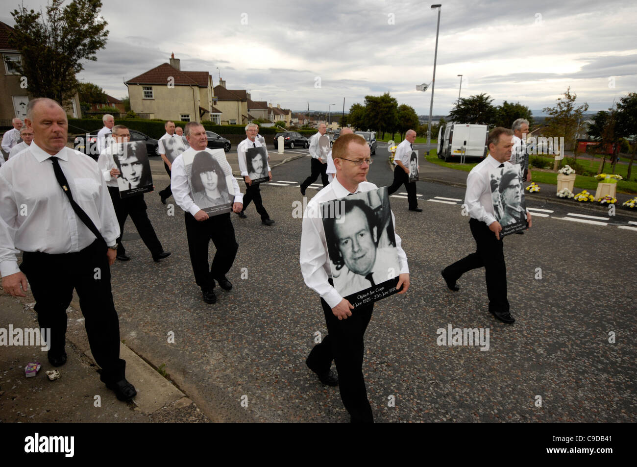 Former Irish republican prisoners marching towards the republican plot in Londonderry, commemorating the IRA dead. - Stock Image