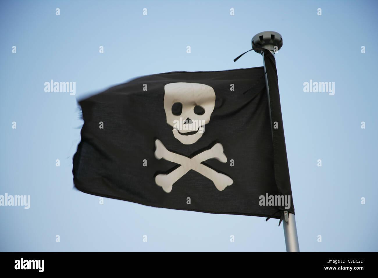 Jolly Roger waving. - Stock Image