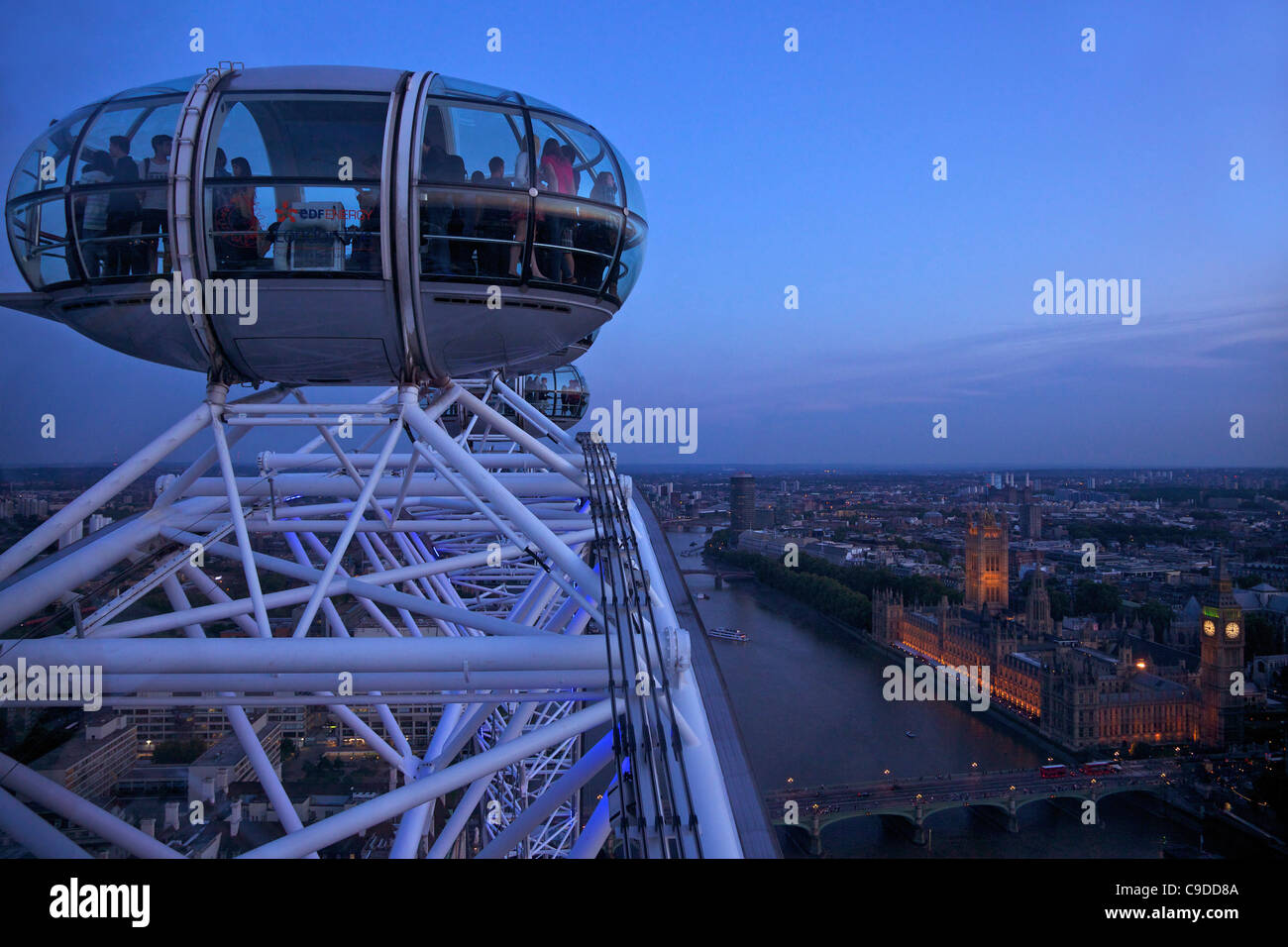 View of passenger pod capsule, Houses of Parliament, Big Ben and the River Thames from the London Eye at dusk,  Stock Photo