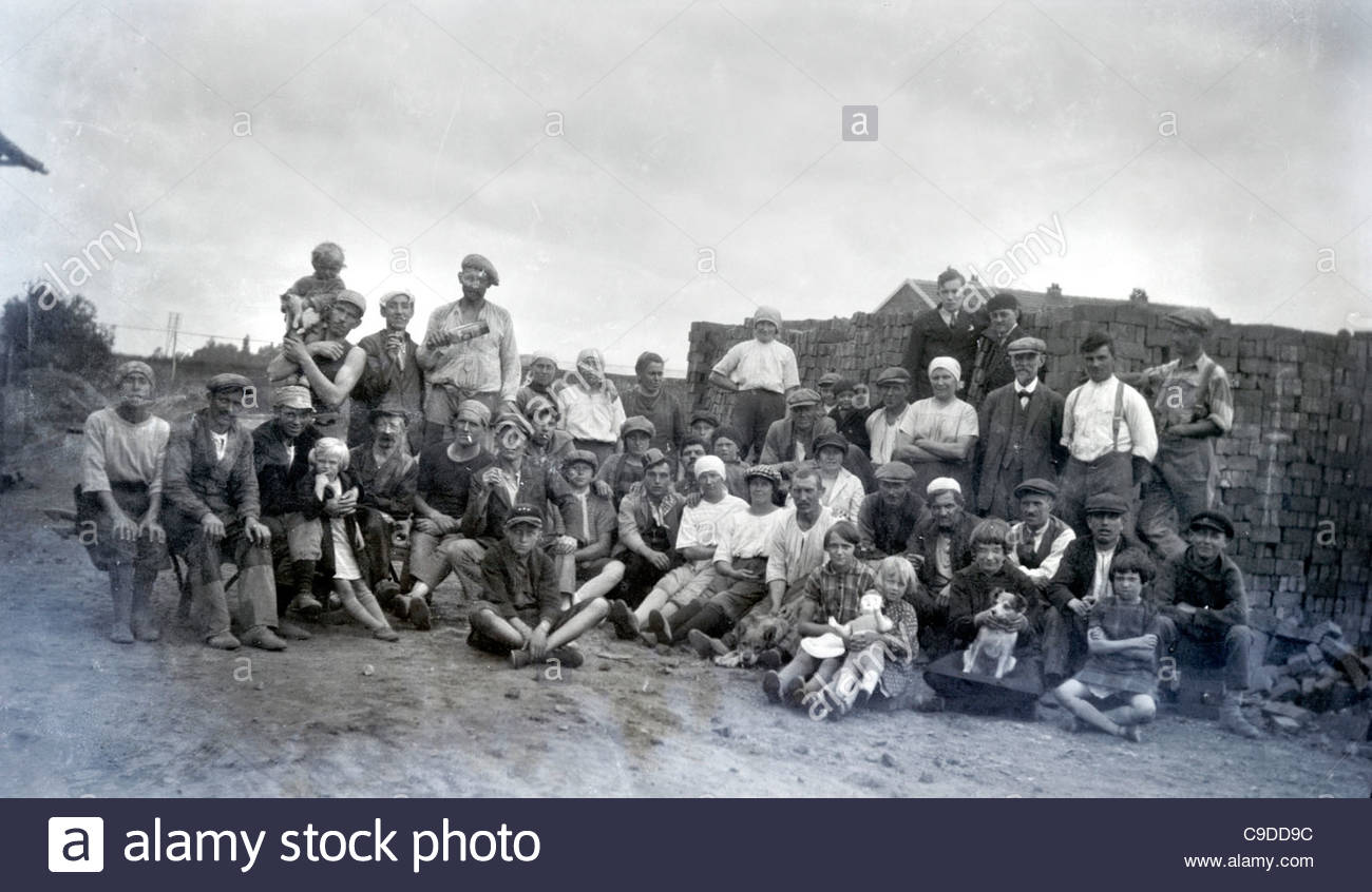 1920s rural masonry workers community group photo - Stock Image
