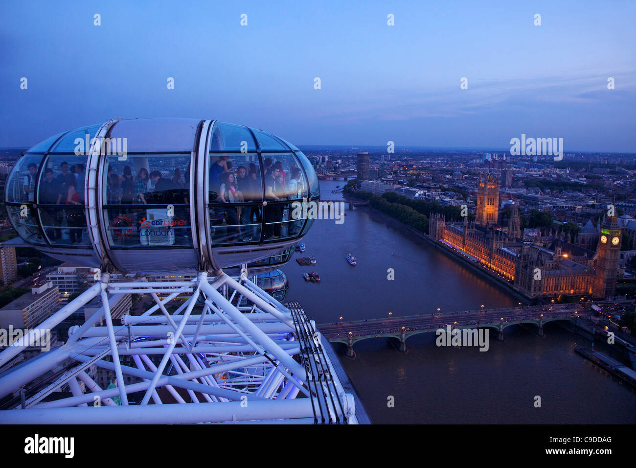 View of passenger pod capsule, Houses of Parliament, Big Ben and the River Thames from the London Eye at dusk,  - Stock Image
