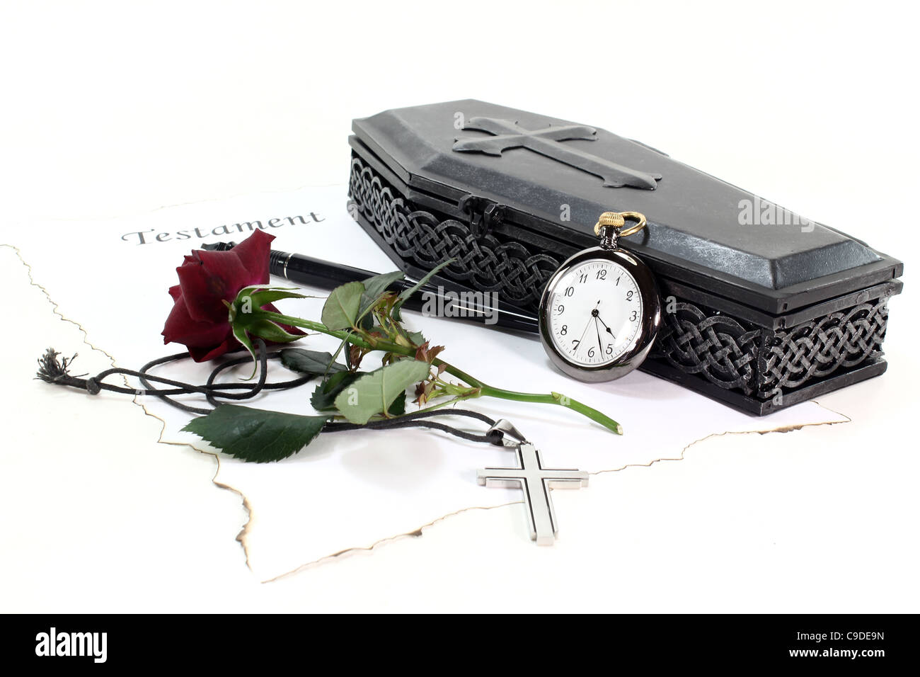 Testament with coffin, a red rose, clock, pen and cross - Stock Image