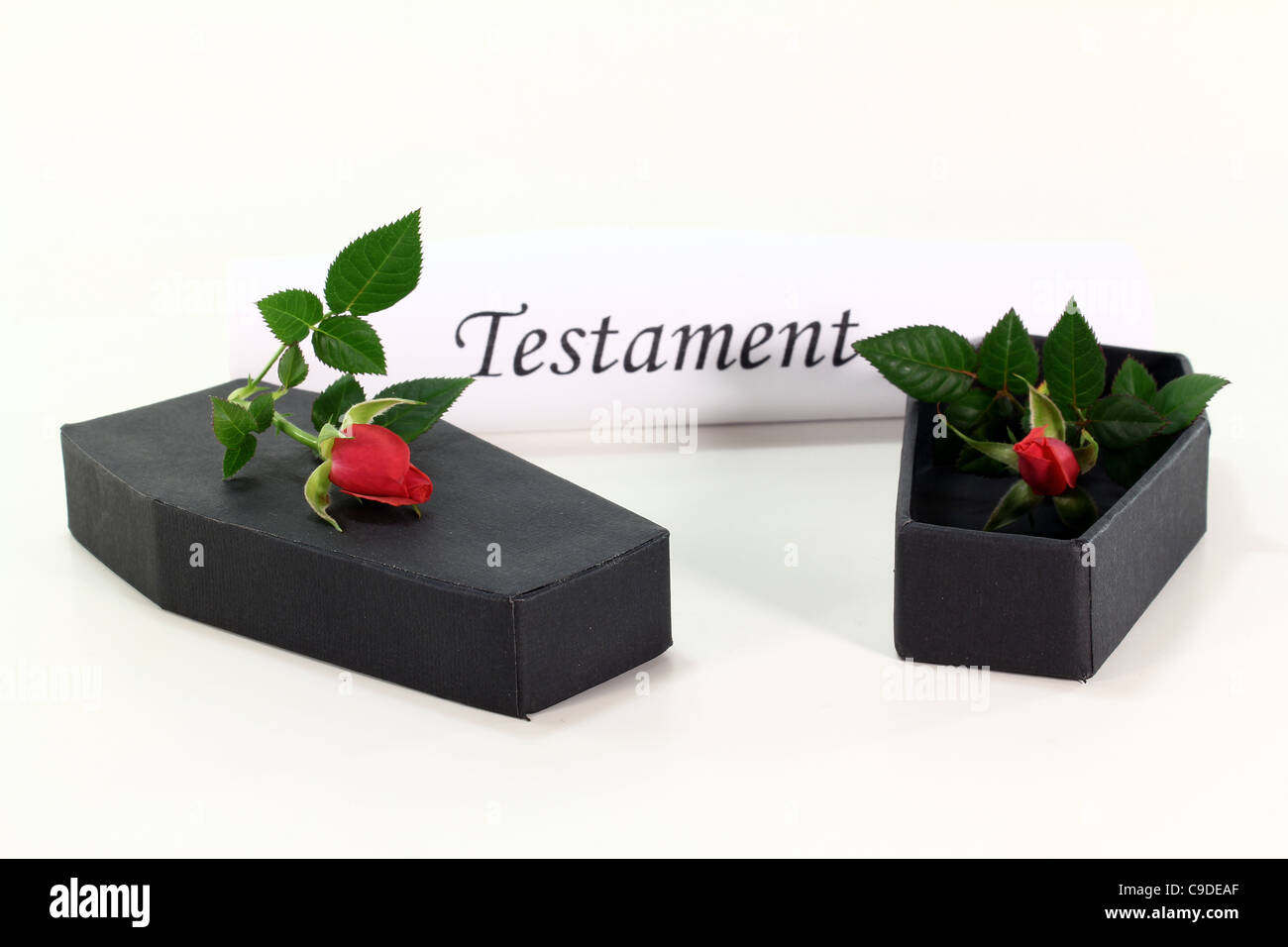 Testament role with coffins and red roses - Stock Image