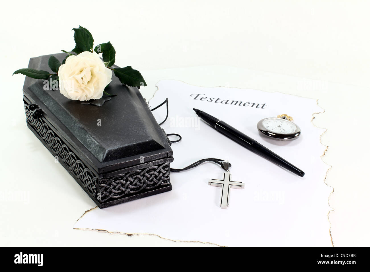 Testament with coffin, a white rose, clock, pen and cross - Stock Image