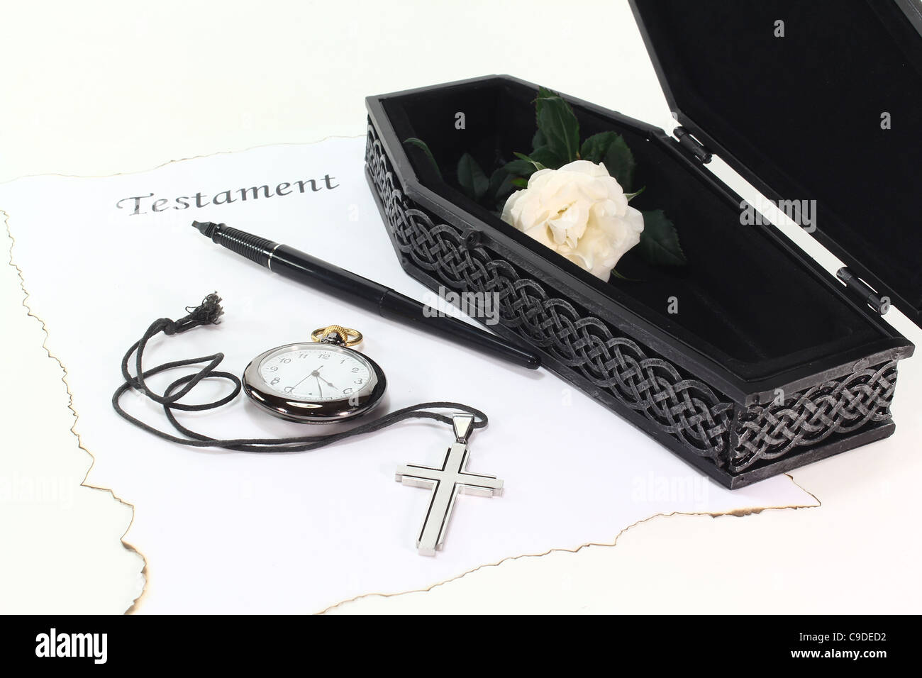 Testament with an open coffin, a white rose, clock, pen and cross - Stock Image